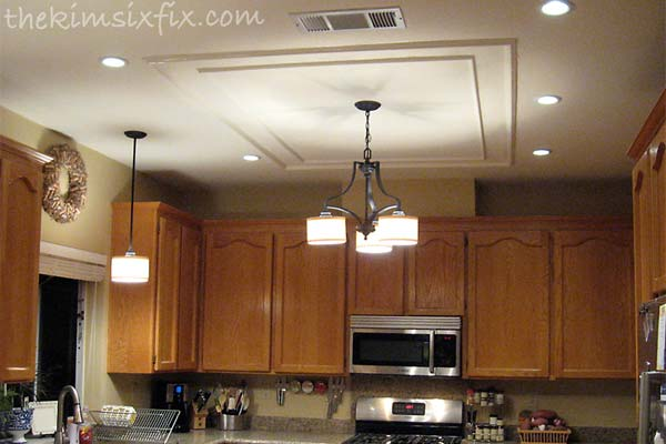 Kitchen after image thekimsixfix com see how she replaced her old light fixture