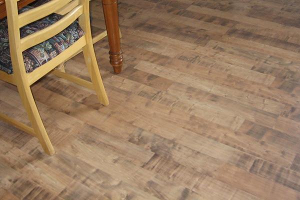 Low-maintenance laminate plank flooring