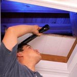 Man conducting his own home energy audit