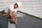 Man installing interlocking metal shingles